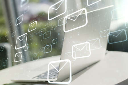 Creative abstract postal envelopes sketch on modern laptop background, e-mail and marketing concept. Double exposure