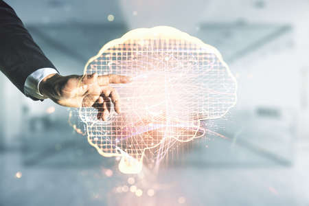 Man hand clicks on virtual creative artificial Intelligence hologram with human brain sketch on blurred office background. Double exposure
