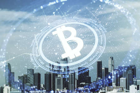 Double exposure of creative Bitcoin symbol hologram on Los Angeles city skyscrapers background. Cryptocurrency concept