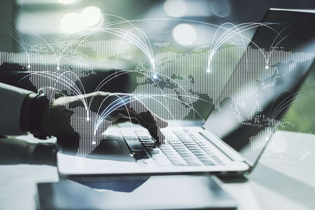 Double exposure of abstract digital world map with connections and hands typing on laptop on background, research and strategy concept