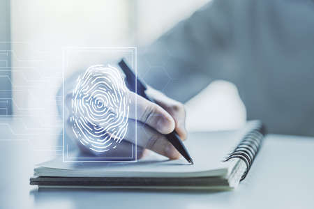 Abstract creative fingerprint concept with man hand writing in notebook on background. Multiexposure Banque d'images