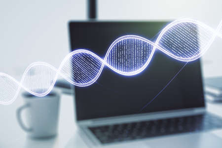 Double exposure of creative DNA hologram on laptop background. Bio Engineering and DNA Research concept