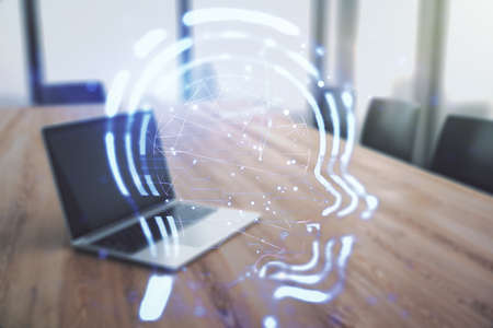 Creative artificial Intelligence concept with human head hologram on modern laptop background. Multiexposure