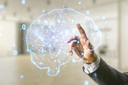 Man hand working with virtual creative artificial Intelligence hologram with human brain sketch on blurred office background. Multiexposure