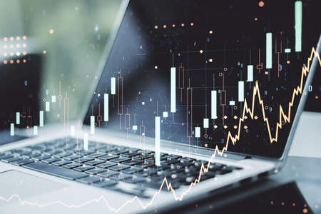 Double exposure of abstract creative financial chart on modern laptop background, research and strategy concept Foto de archivo
