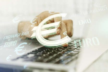 Creative EURO symbols illustration and hands typing on computer keyboard on background, forex and currency concept. Multiexposure