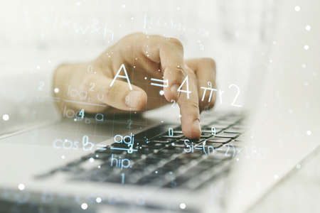 Creative scientific formula hologram with hands typing on computer keyboard on background, research concept. Multiexposure Banque d'images