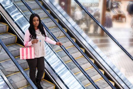Beautiful African American Woman at Shopping Mall Banco de Imagens
