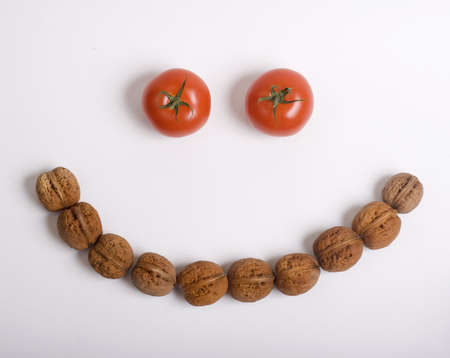Tomatoes and walnuts  smiley face Stock Photo