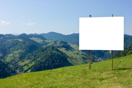 outdoor blank billboard: ad panel on a mountain view Stock Photo