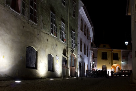 night viev of a street in sighisoara romania