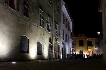 night viev of a street in sighisoara romania
