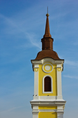 catholic church tower isolated on blue sky