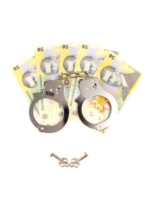 handcuffs and romanian money Stock Photo - 11512774