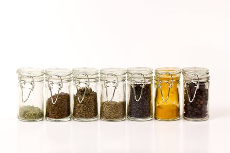 group of closed jars with spices Stock Photo