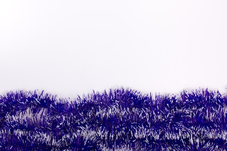 blue tinsel isolated on white photo