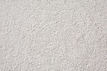 Uniform detail of a white wall with rough texture