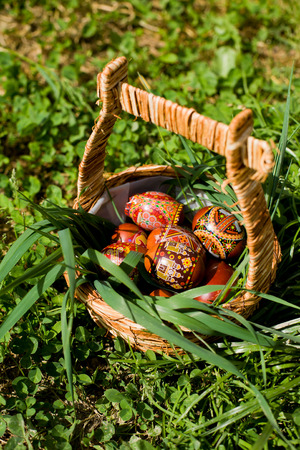 Detail of a romanian traditional easter bascket ornated with green grass Stock Photo