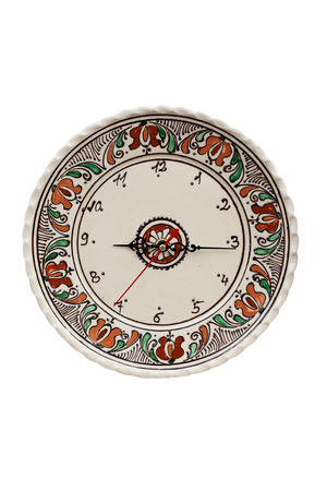 Traditional romanian pottery clock islated on white Stock Photo