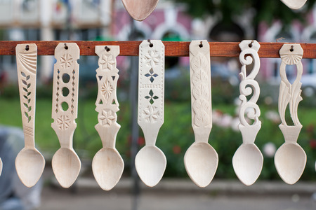 romanian: Detail of a variety of sculpted romanian traditional wooden spoons Stock Photo