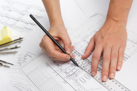 Architect working on blueprint. Architects workplace - architectural project, blueprints, ruler, calculator, laptop and divider compass. Construction concept. Engineering tools. 版權商用圖片 - 50802844