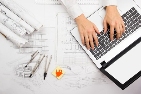 house blueprint: Architect working on blueprint. Architects workplace - architectural project, blueprints, ruler, calculator, laptop and divider compass. Construction concept. Engineering tools.