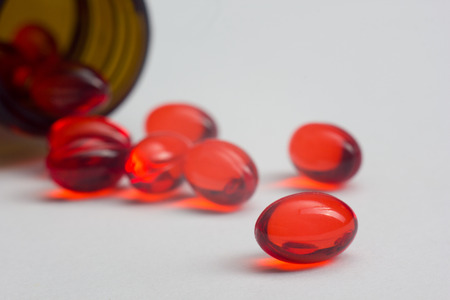 helthcare: Red pills on table. Helthcare and Medical background Stock Photo
