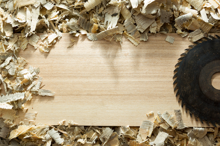 Carpenter tools on wooden table with sawdust. Carpenter workplace top view. Stock Photo