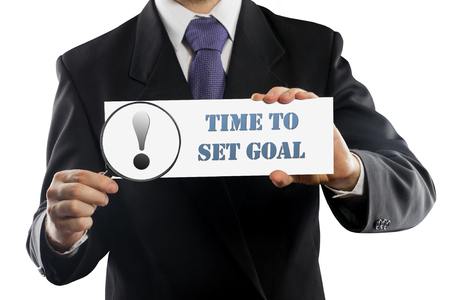 set goal: Close up businessman or salesman holding in hands magnifying glass and paper with Time To Set Goal message isolated on white background Stock Photo