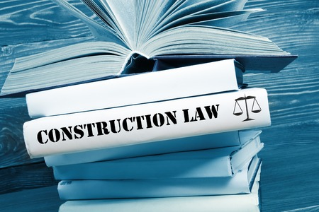 arbitrate: Law concept - Law book with Construction Law word on table in a courtroom or law enforcement office. Toned image. Stock Photo