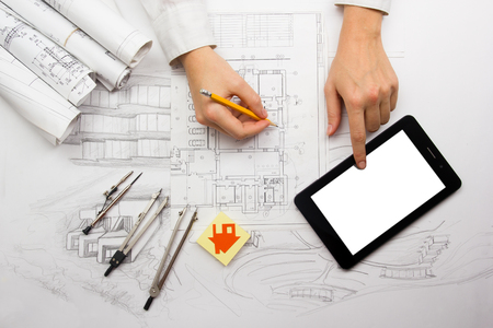Architect working on blueprint. Architects workplace - architectural project, blueprints, ruler, calculator, laptop and divider compass. Construction concept. Engineering tools. Stok Fotoğraf - 50995294