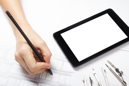 architect tools: Architect working on blueprint. Architects workplace - architectural project, blueprints, ruler, calculator, laptop and divider compass. Construction concept. Engineering tools.