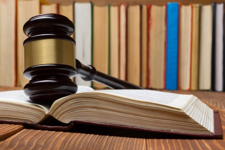 legal books: Law concept - Law book with a wooden judges gavel on table in a courtroom or law enforcement office Stock Photo