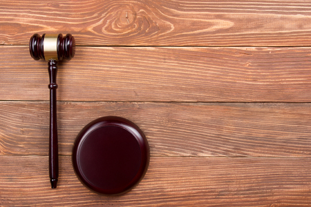 Law concept - Law book with a wooden judges gavel on table in a courtroom or law enforcement office Standard-Bild