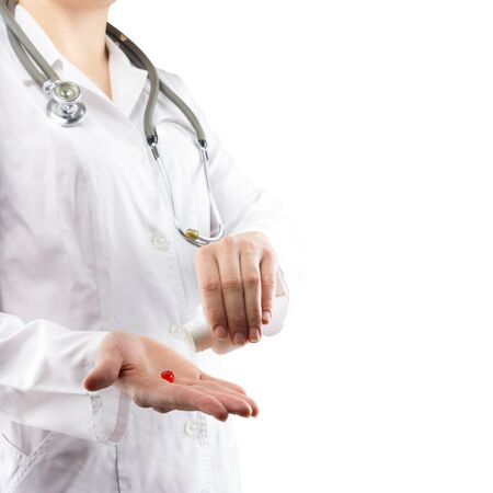 doctor giving glass: Female doctors hand giving pills. Close up shot on grey blurred background. Concept of Healthcare And Medicine.