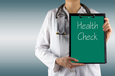 Health Check  - Female doctor's hand holding medical clipboard and stethoscope. Concept of Healthcare And Medicine. Copy space. Banque d'images