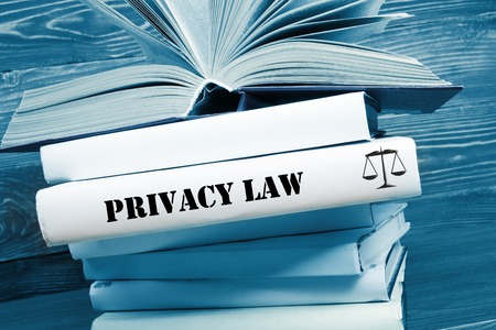 Law concept - Law book with Privacy Law word on table in a courtroom or law enforcement office. Toned image.