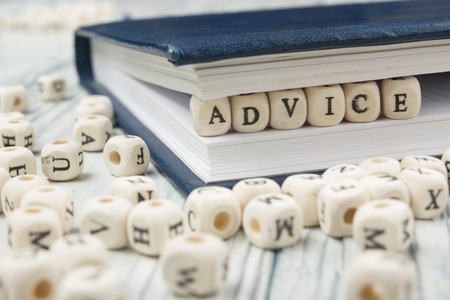 business advice: Wooden Blocks with the text Advice. Wooden ABC Stock Photo