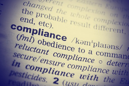 compliant: Definition of the word Compliance. Toned image. Stock Photo