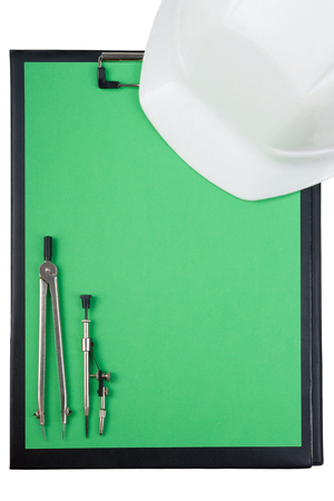 paper board: Workplace of architect - Architectural project, plan, blueprint rolls and pen, safety helmet on blank sheet of paper. Engineering tools view from the top. Construction background. Copy space Stock Photo