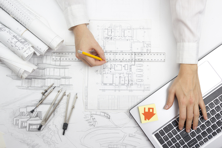 Architect working on blueprint. Architects workplace - architectural project, blueprints, ruler, calculator, laptop and divider compass. Construction concept. Engineering tools. Stok Fotoğraf - 51106201