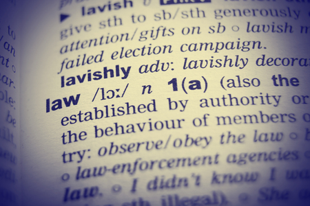 lawful: Dictionary definition of the word Law with vignetting effect