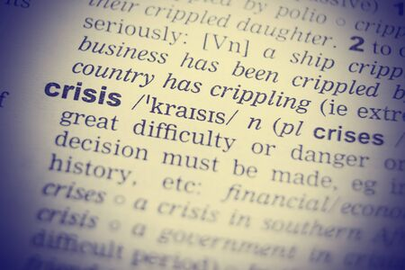 glossary: Close up shot of the word crisis from a dictionary. Stock Photo