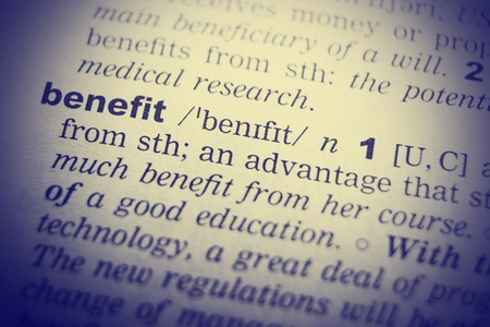 English dictionary: Benefits definition . Close up of English dictionary page with word Benefit.