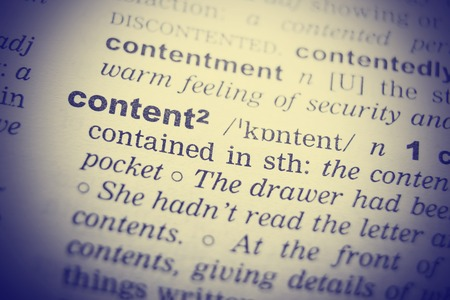 english dictionary: Close up of English dictionary page with word Content. Stock Photo
