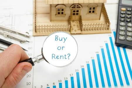 renter: Magnifying glass with  text Buy or Rent in a concept image. Stock Photo