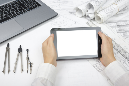 Architect working on blueprint. Architects workplace - architectural project, blueprints, ruler, calculator, laptop and divider compass. Construction concept. Engineering tools. Stok Fotoğraf - 51812909