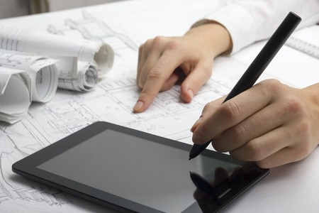 engineering tools: Architect working on blueprint. Architects workplace - architectural project, blueprints, ruler, calculator, laptop and divider compass. Construction concept. Engineering tools.