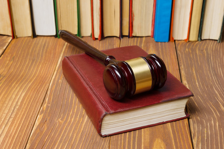 prosecutor: Law concept - Law book with a wooden judges gavel on table in a courtroom or law enforcement office Stock Photo