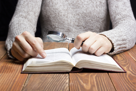 pocket book: Closeup woman hand  holding pocket book to read.